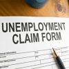 US unemployment claims fall to three-month lows