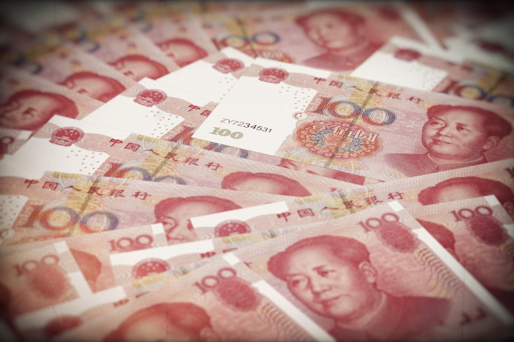 Chinese Yuan Gains as Central Bank Cools Markets Over Policy Easing